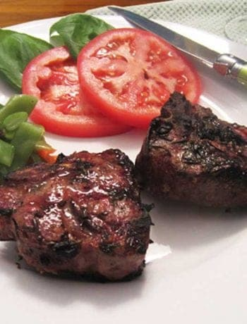 Grilled Lamb Chops on a white plate with sides square
