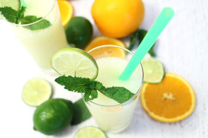 Overhead of one limeade showing color of drink on white table.