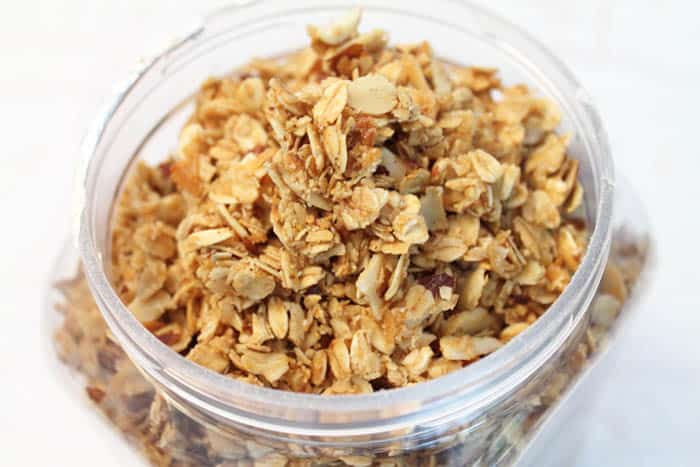 Closeup overhead of granola in container.