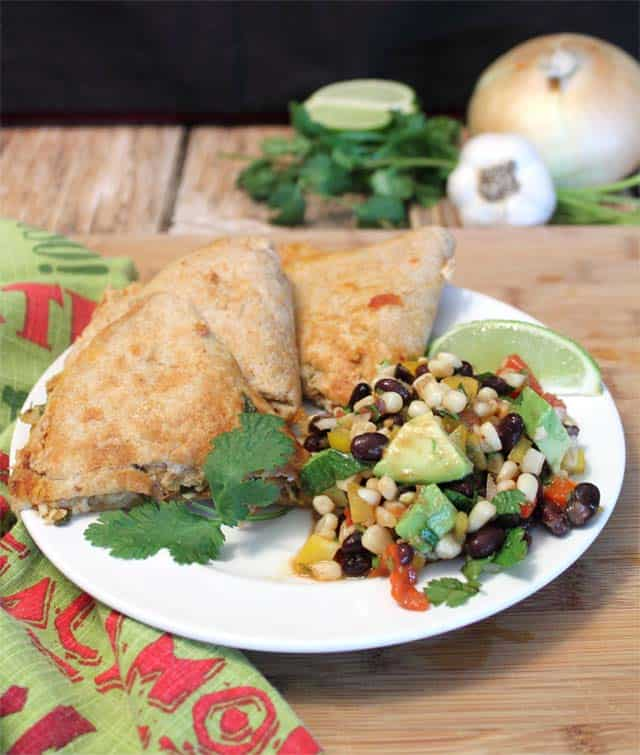 Black Bean Salad plated with quesadillas.