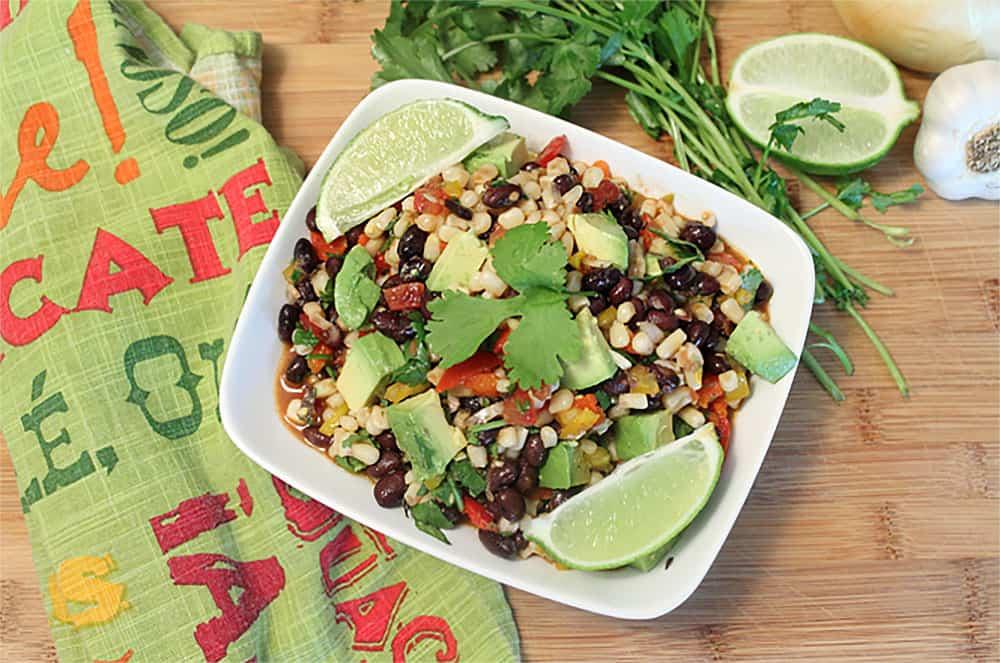 Southwest Salad in white bowl with cilantro.