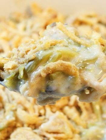 Closeup of spoonful over hot casserole.
