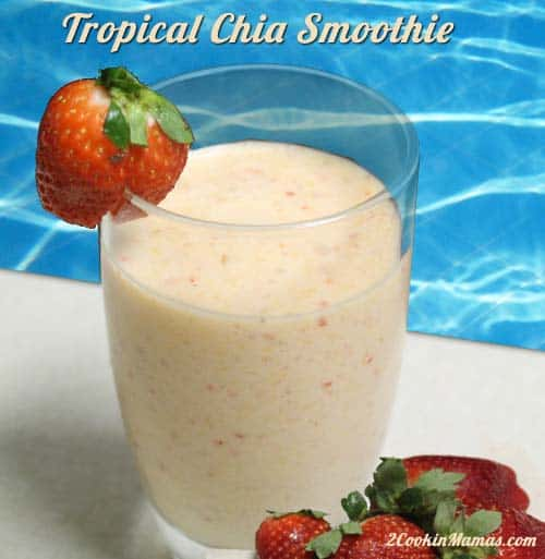 Our Tropical Chia Smoothie is perfect for summer. Packed with healthy, delicious strawberries, banana, pineapple, mango & coconut, it\'s tropical to the max! #smoothie #healthysmoothie #chiaseeds #strawberries