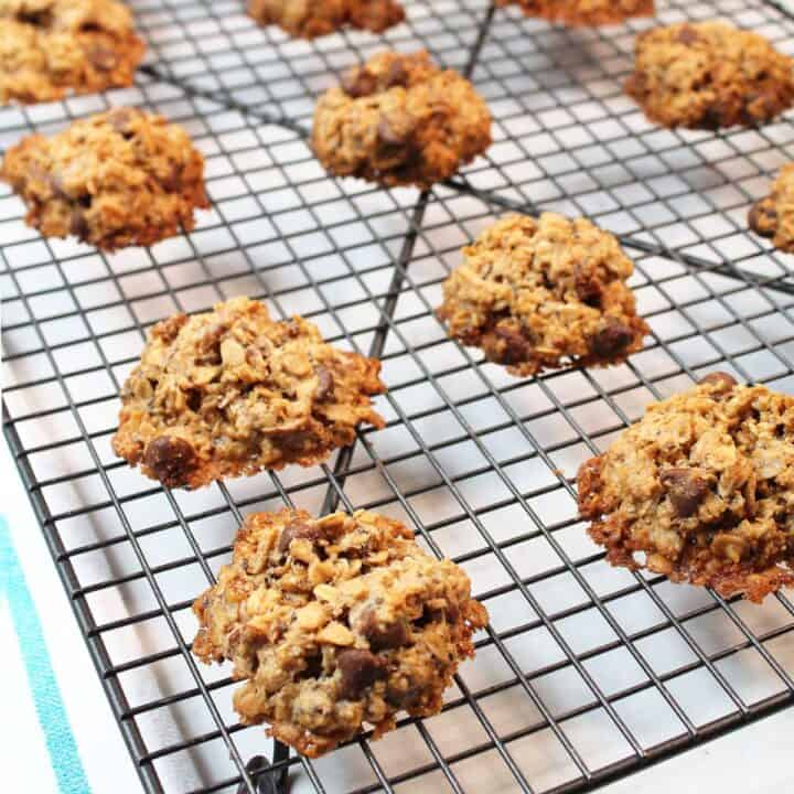 Gluten-free oatmeal cookies cooking on wire rack.