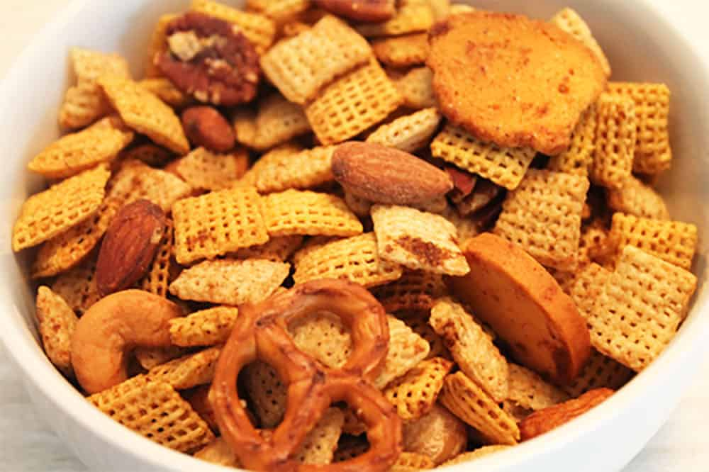 GF Chex Mix in white bowl.