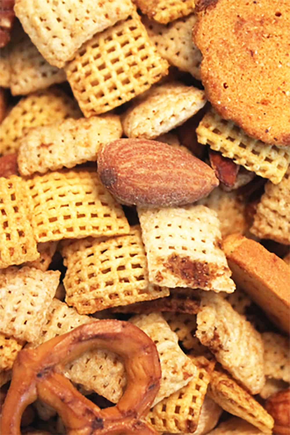 Snack mix closeup on cookie sheet.