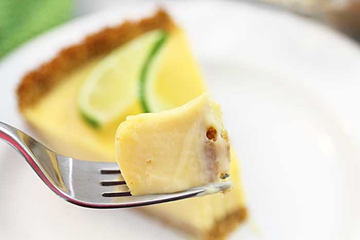 a closeup of a bite of creamy key lime filling