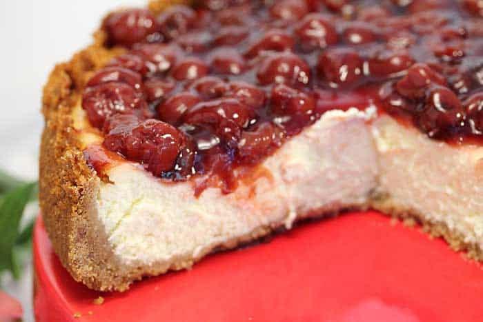 New York Cheesecake with cherries closeup   2 Cookin Mamas