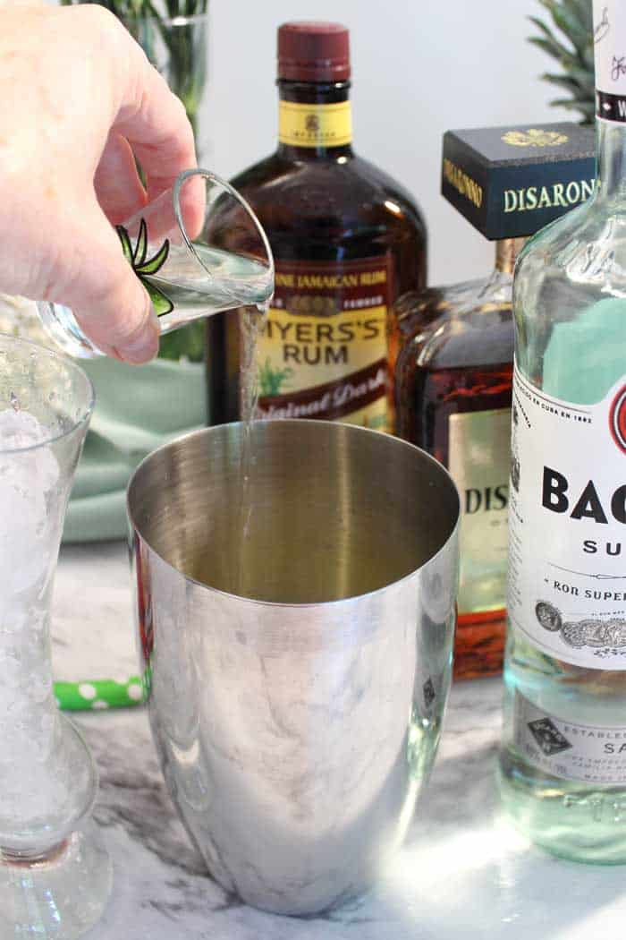 adding rum to cocktail