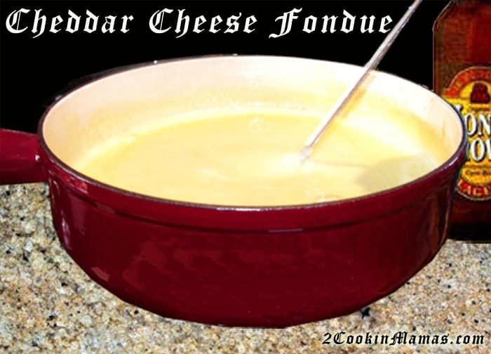 Any season is the perfect time for a rich & creamy cheddar cheese fondue. You\'ll flip over this simple & tasty Melting Pot copycat fondue recipe. #fondue #cheesefondue #appetizer #cheddarcheese