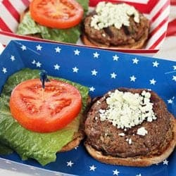 Closeup of burger with lettuce and tomato in a patriotic tray