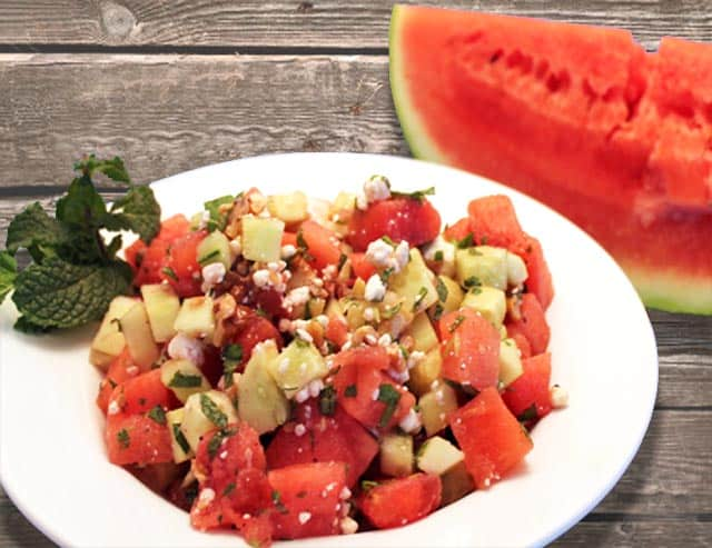 Watermelon, Cucumber and Mint Salad on picnic table | 2 Cookin Mamas