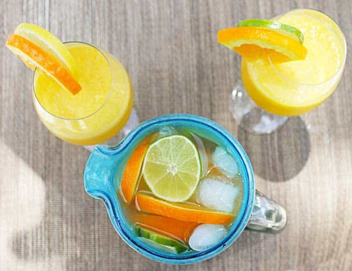 Sunshine Sangria garnishes of sliced fruit