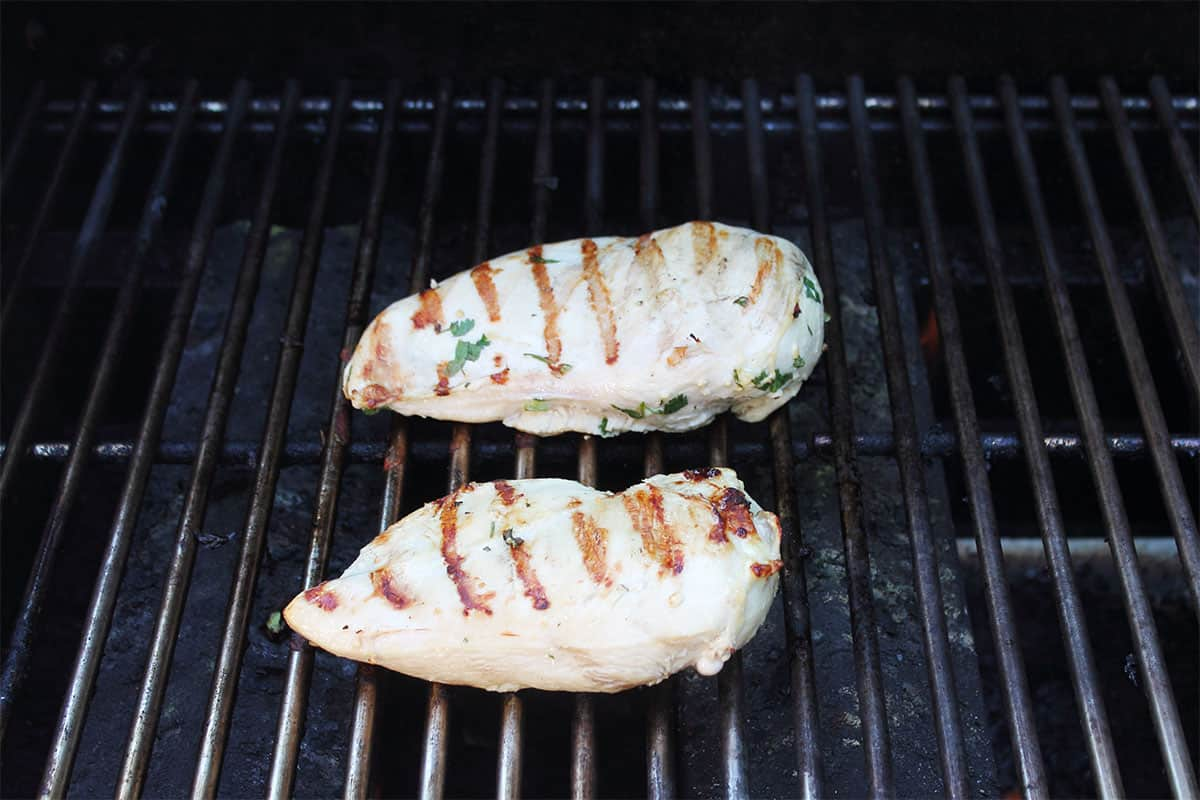 Grilling chicken breasts.
