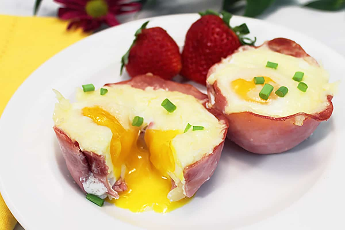 Inside of baked ham and egg cup showing liquid yolk.