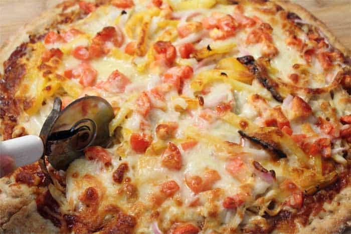 BBQ Chicken Pizza slicing