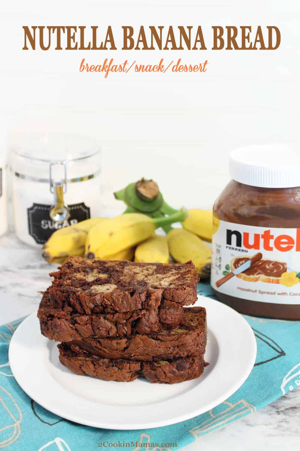 Nutella Banana Bread tall | 2 Cookin Mamas A sweet & delicious banana bread with a surprise inside - Nutella! This Nutella Banana Bread has all the moist and delicious taste of a banana bread with loads of everyone's favorite spread swirled throughout. Serve it as a special breakfast treat, a snack or top it with a chocolate glaze for a fabulous dessert.#bananabread #quickbread #bananas #nutella #breakfast #dessert #snack #recipe