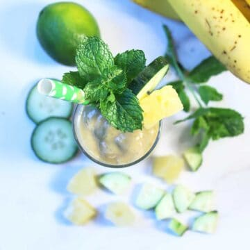 Overhead of garnished pineapple smoothie.