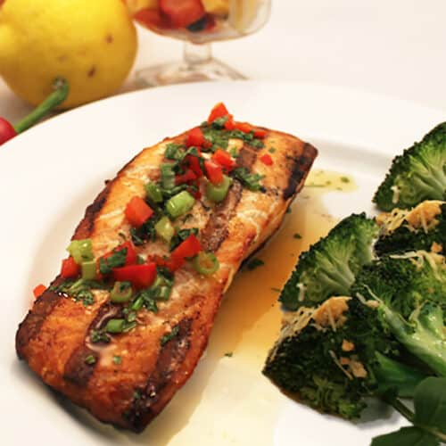 Grilled Salmon with Spicy Orange Sauce close up.