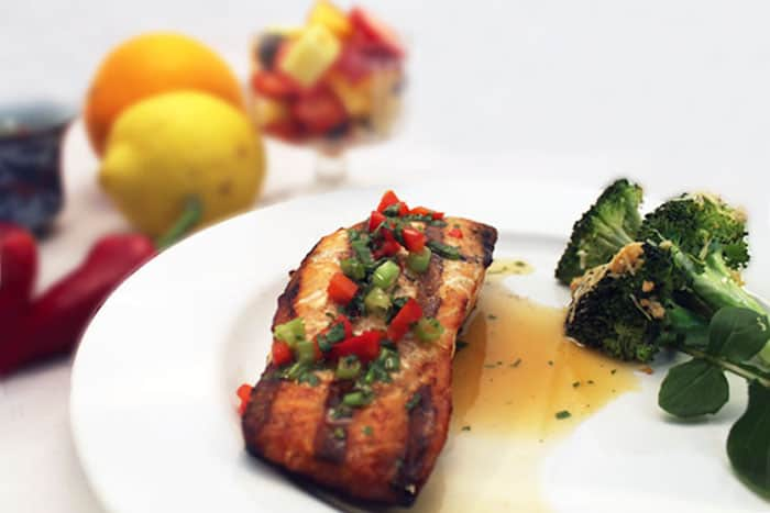 Grilled orange salmon and broccoli on a plate