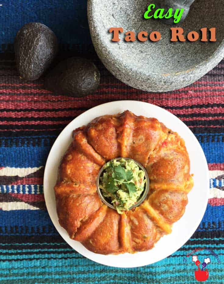Taco Roll main | 2 Cookin Mamas Love tacos? Pull this easy taco roll together using crescent rolls, ground, beef, refried beans and cheese. Great for dinner, a buffet or an appetizer.