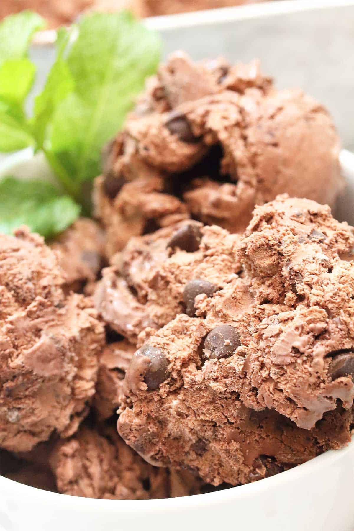 Extreme closeup of partial bowl of ice cream.