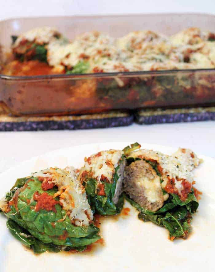 Kale Wrapped Mozzarella Stuffed Meatballs cut