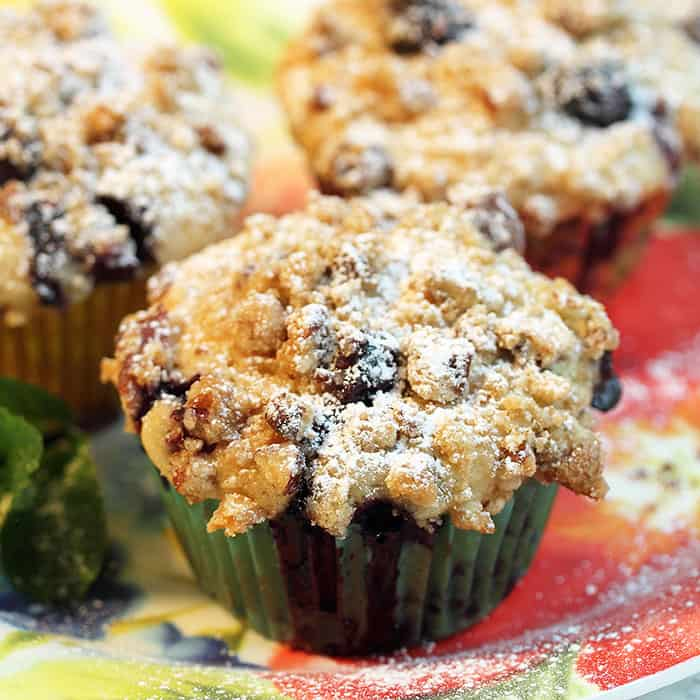 Closeup of blueberry muffin with powdered sugar.