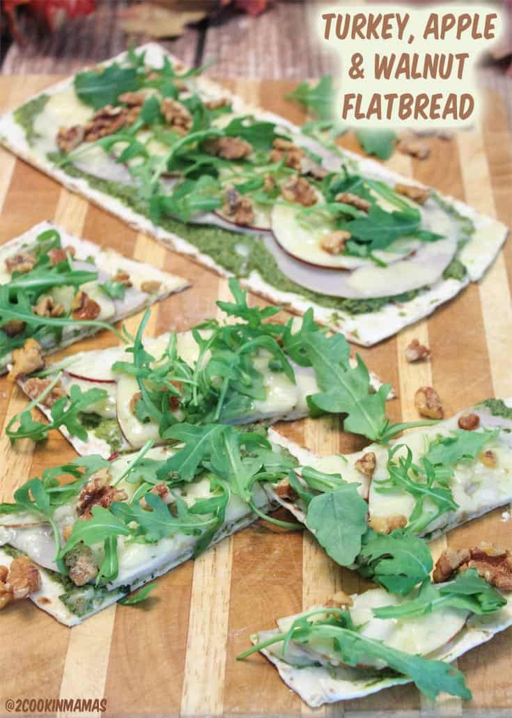 Turkey Apple Pesto Flatbread | 2 Cookin Mamas - a healthy snack for game time or a satisfying lunch. Piled high with lowfat turkey, walnut pesto and apple slices. Yum! #appetizer #flatbread #gameday #healthy #lowfat #turkey #apples #cheese #walnuts #recipe