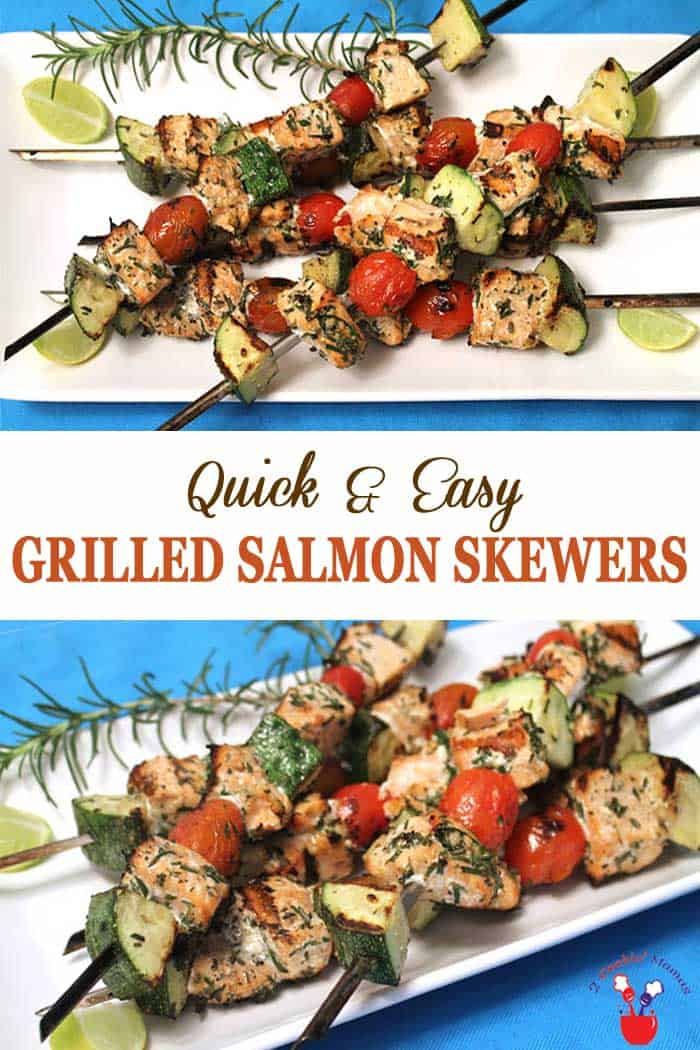 Grilled Salmon Skewers | 2 Cookin Mamas Turn up the heat, on your grill that is! These delicious grilled salmon skewers are like a complete meal on a stick. Fresh salmon, cherry tomatoes and zucchini tossed in a seasoned vinaigrette then grilled. Healthy, quick & with little to no cleanup. #salmon #grilling #grilledsalmon #dinner #easyrecipe