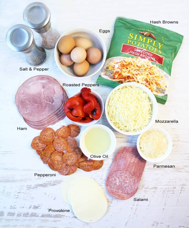 Ingredients for Italian Egg Bake laid out on white table and labeled.