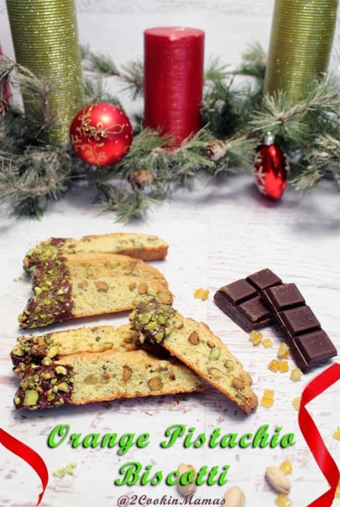 Orange Pistachio Biscotti pin 2CookinMamas - This cookie has tons of orange flavor, pistachios galore and better yet, dipped in chocolate with more pistachios! Great with coffee for a morning breakfast treat.