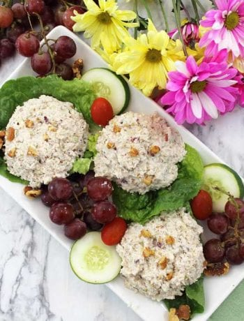 Chicken Salad with Grapes on platter overhead with flowers.