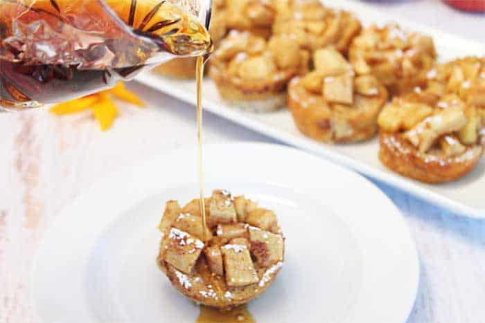 Apple French Toast Muffins pouring syrup