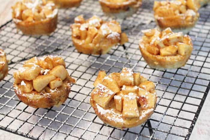 Apple French Toast Muffins cooling on rack