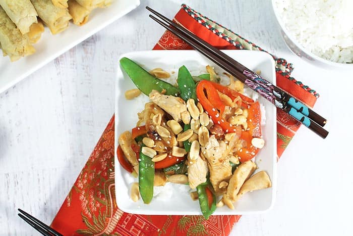Easy Chicken Stir Fry plated on white plate with chopsticks overhead.