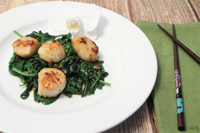 Seared Sea Scallops over Garlic Spinach plated | 2 Cookin' Mamas