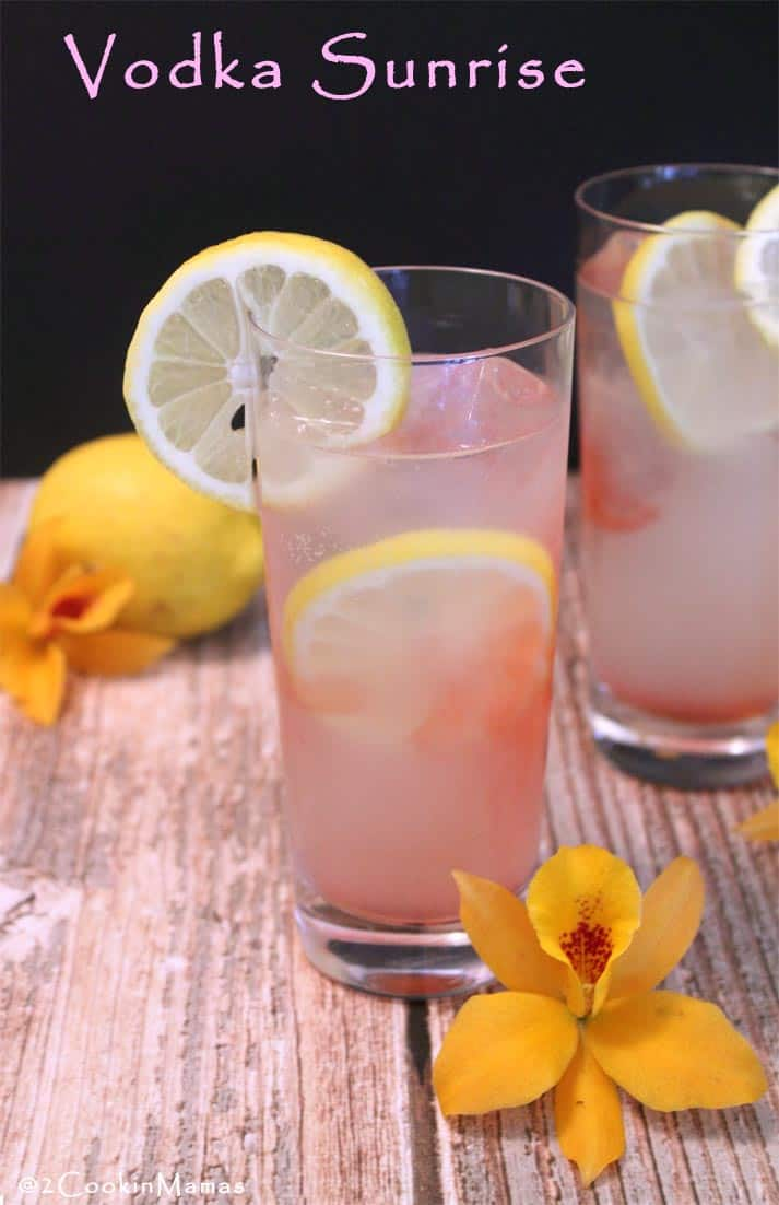 Vodka Sunrise | 2CookinMamas The perfect drink for warm summer days. A refreshing combination of lemon soda, coupled with vodka & a touch of cherry juice,, makes this one refreshing cocktail!