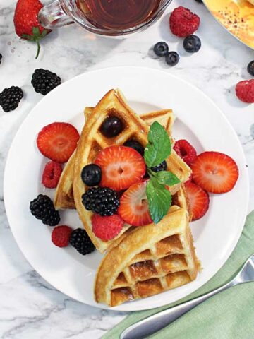 Quartered waffles on plate square