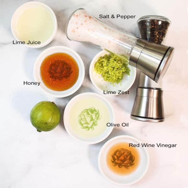 Dressing ingredients labeled on white table.