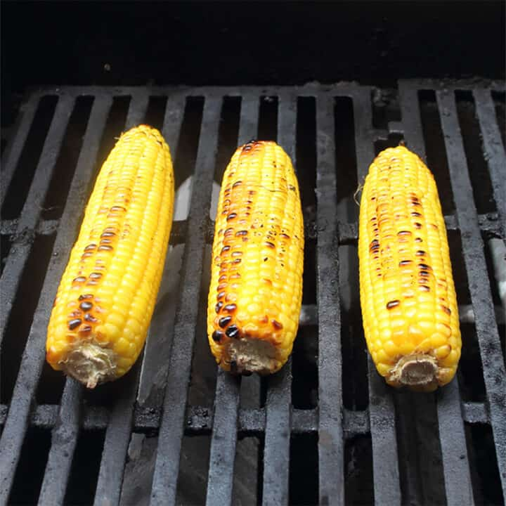 Cooking corn on the grill.