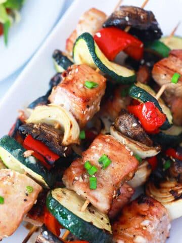 Overhead of Korean BBQ skewers on platter.