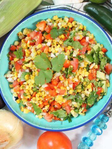 Overhead of roasted corn and avocado salad.