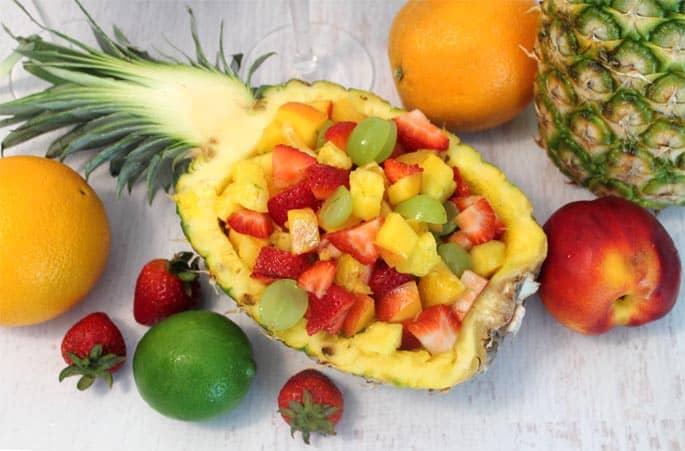 Fruit Cocktail Dessert pineapple bowl | 2 Cookin Mamas