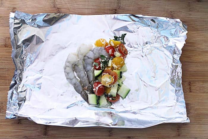 Garlic shrimp and vegetables on a sheet of foil