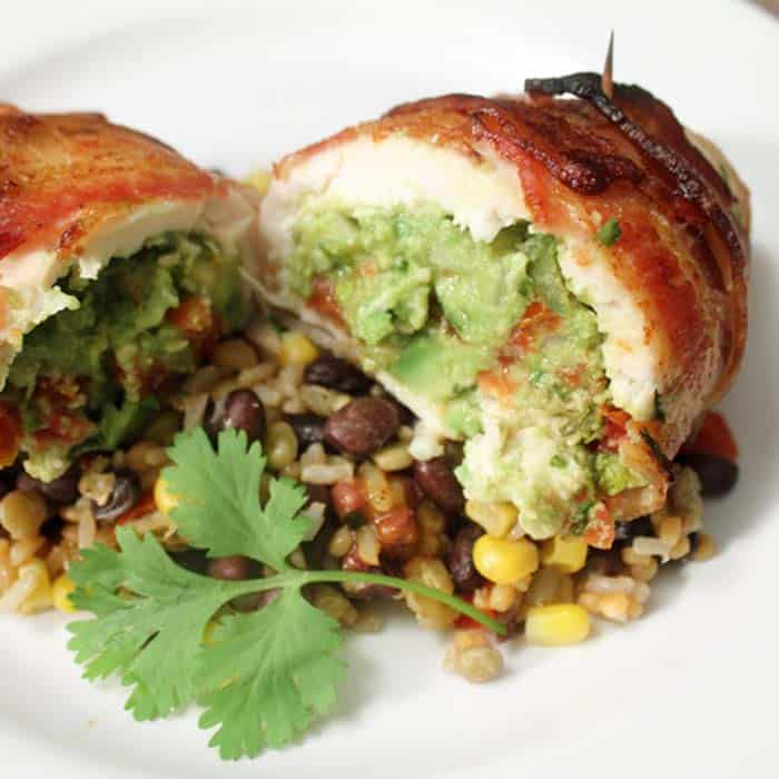 Closeup of guacamole stuffing on top of lentil vegetables.