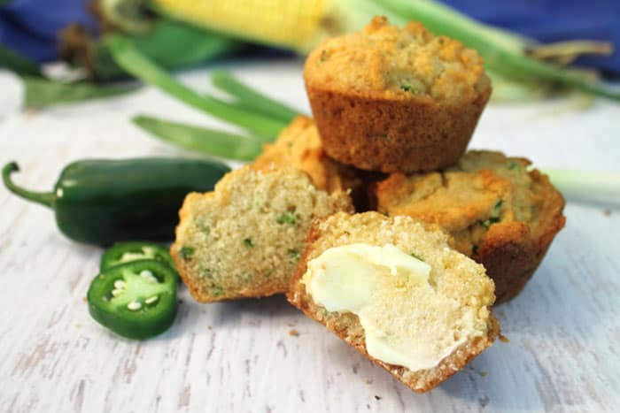 Green Onion Jalapeno Cornbread Muffins with butter | 2 Cookin Mamas