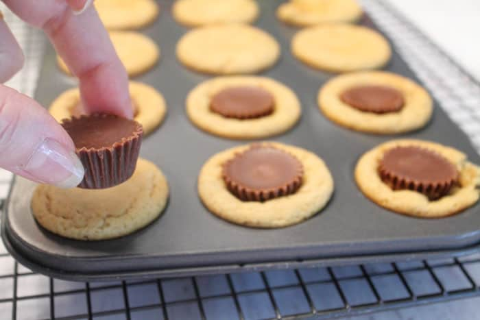 Peanut Butter Cup Cookies inserting cup | 2 Cookin Mamas