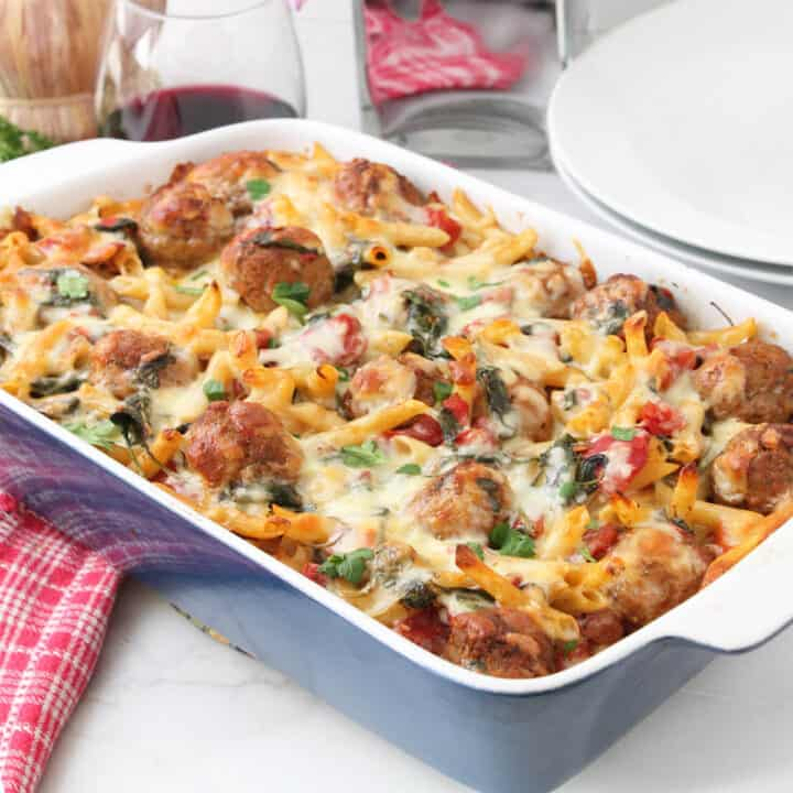 Baked casserole with wine and flowers.