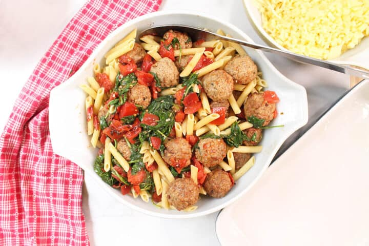 Mix meatballs and pasta with tomato sauce.